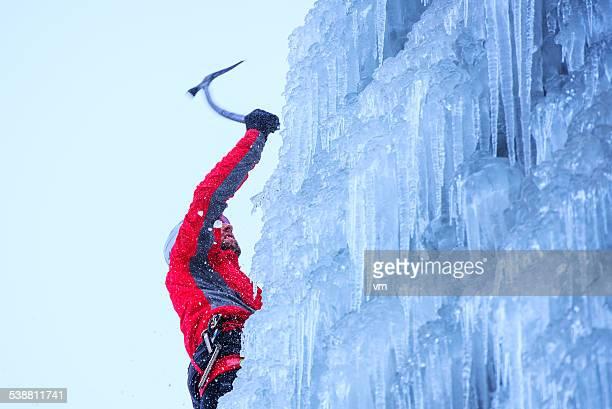 Ice Climber Ascending a Frozen Waterfall