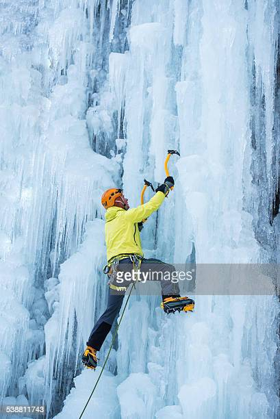 Ice Climber Ascending a Frozen Waterfall