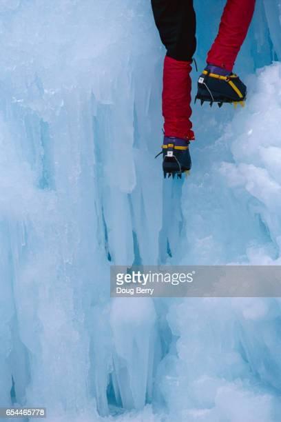 Ice Climber Scaling Mountain