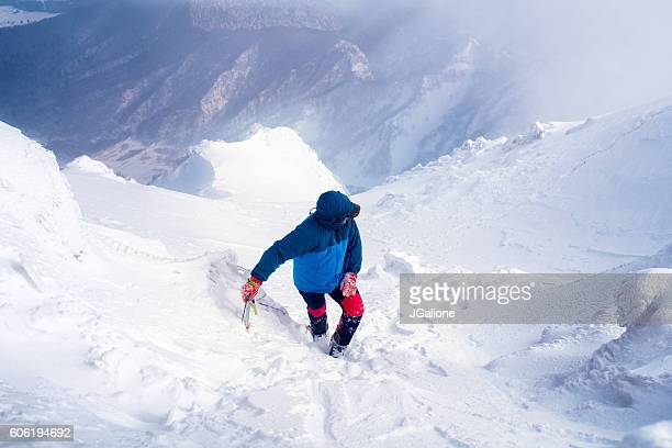 Ice climber taking a short break on a mountain