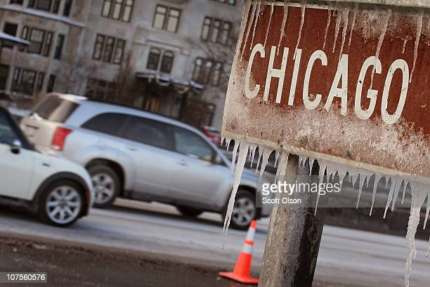 Ice clings to a sign along Lake Shore Drive after wind gusts upwards of 40 miles per hour blew waves onto the shore and temperatures in the low teens...