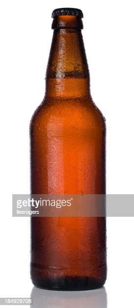 Ice cold bottle of beer isolated on a white background