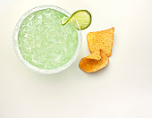 Ice cold margarita with tortilla chips