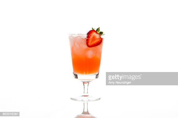 Ice cold strawberry cocktail on white background.