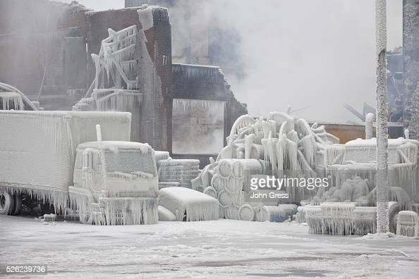 Ice covered trucks are blanketed in smoke January 23 after a warehouse fire in Chicago Fire Department officials said it is the biggest fire the...