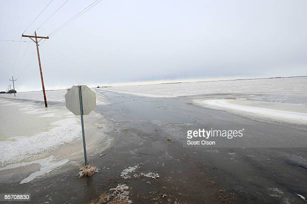 Ice covers a flooded rural road March 30 2009 near Fargo North Dakota Residents of Fargo are now bracing for a blizzard that is expected to dump as...