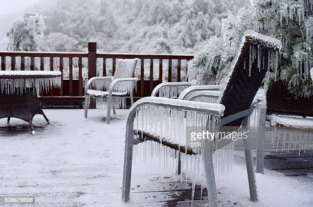 Ice covers a terrace in Hangzhou in eastern China's Zhejiang province on January 25 2016 Snow sleet and icy winds across Asia caused deaths flight...