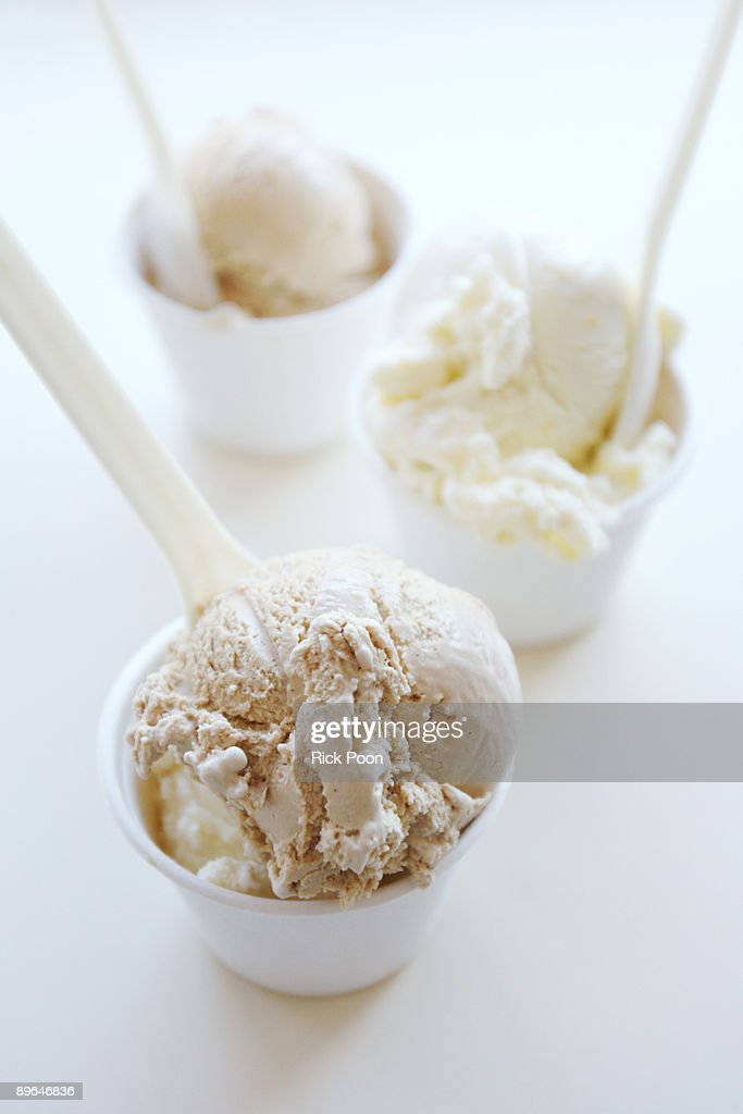 Ice cream in cups on white : Stock Photo