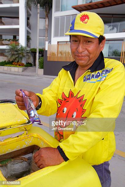 Ice cream vendor vending cart man holding ice cream bar Malecon Souza