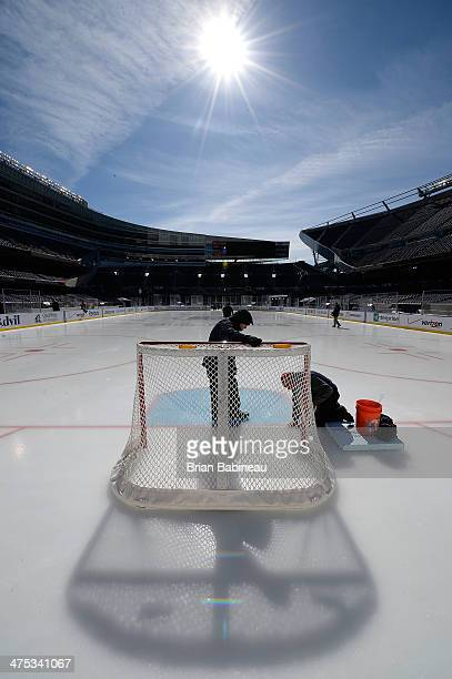 Ice crew workers work on the ice surface during the 2014 NHL Stadium Series rink build out on February 27 2014 in Chicago Illinois