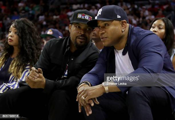 Ice Cube and LL Cool J talk during week two of the BIG3 three on three basketball league at Spectrum Center on July 2 2017 in Charlotte North Carolina