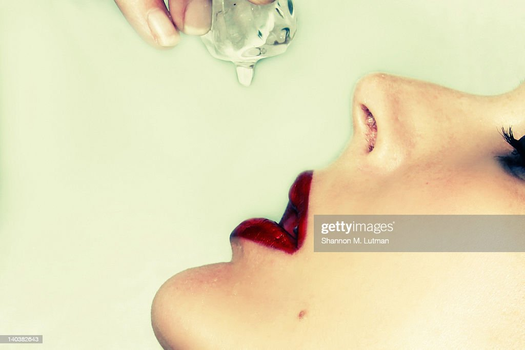 Ice cube lips : Stock Photo