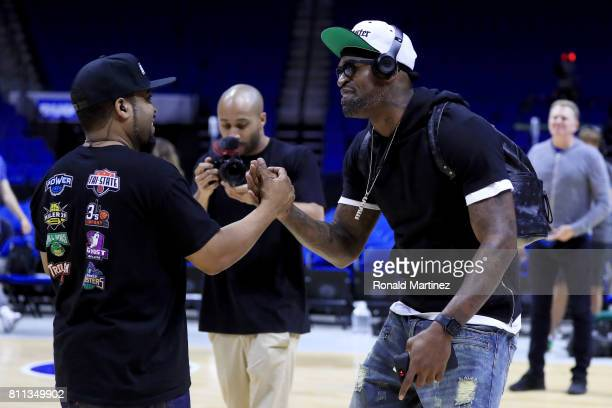 Ice Cube meets with Stephen Jackson of the Killer 3s during week three of the BIG3 three on three basketball league at BOK Center on July 9 2017 in...