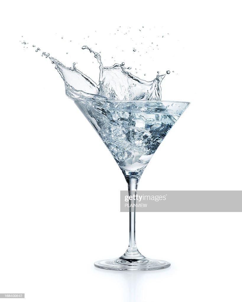 Ice cube splashing in Martini