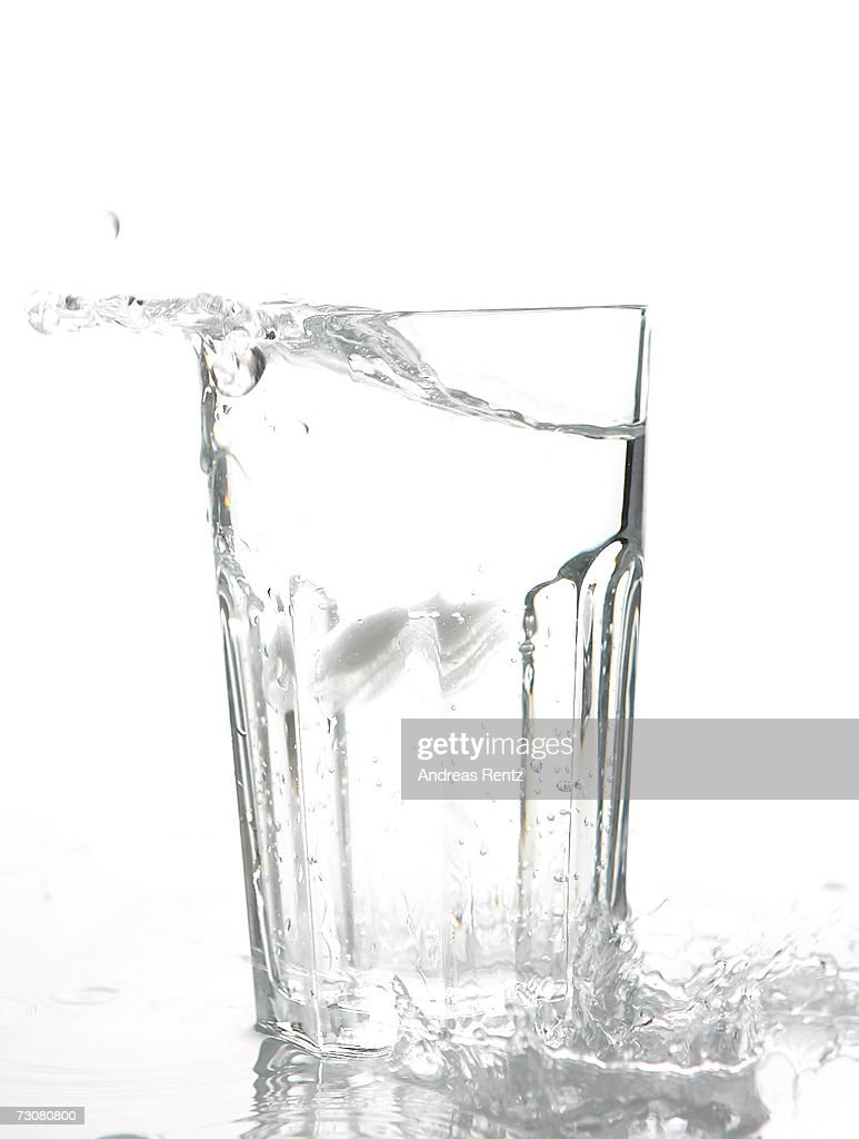 Ice cubes drop into a glass of water on January 14, 2007 in Berlin, Germany.