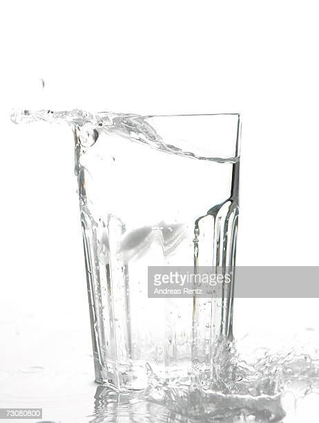 Ice cubes drop into a glass of water on January 14 2007 in Berlin Germany