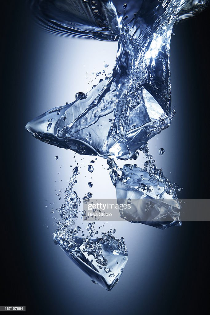 Ice cubes falling in water