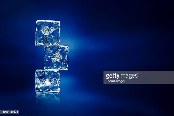 Ice Cubes on blue - Water frozen cold fresh
