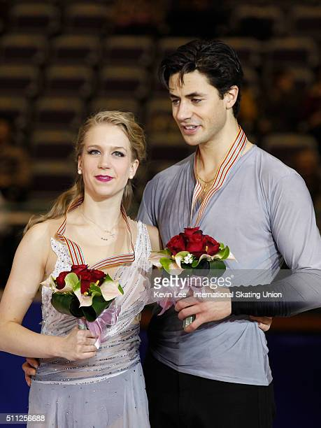 Ice Dance Bronze medallists Kaitlyn Weaver and Andrew Poje of Canada stand on the podium after the Ice Dance Free Dance performance on day two of the...