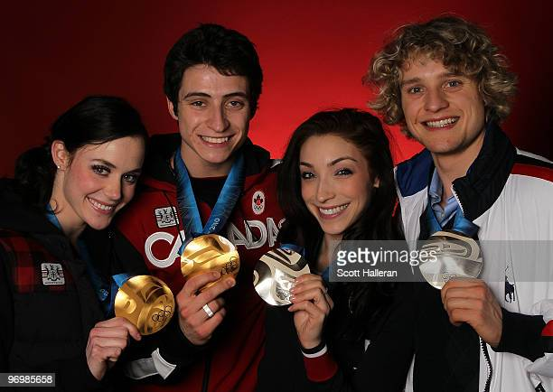 Ice dance figure skaters Tessa Virtue and Scott Moir of Canada pose with their gold medals alongside silver medal winners Meryl Davis and Charlie...