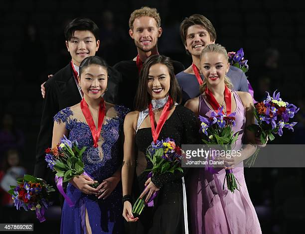 Ice Dance Free Dance winners Maia Shibutani Alex Shibutani Madison Chock Evan Bates Alexandra Stepanova and Ivan Bukin pose after the 2014 Hilton...