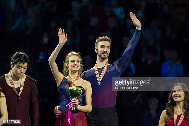 Ice Dance gold medalists Gabriella Papadakis and Guillaume Cizeron of France wave to the crowd following the medal ceremonies at the ISU World Figure...