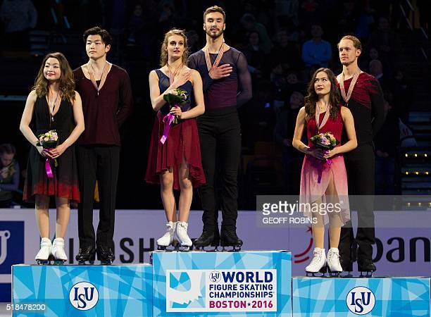 Ice Dance Gold Medalists Gabriella Papadakis and Guillaume Cizeron of France sing their national anthem as silver medalists Maia Shibutani and Alex...