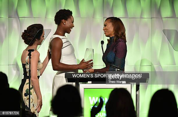 Ice Dancer Meryl Davis and Track Field athlete Sanya RichardsRoss present Water Polo player Ashleigh Johnson with the Individual Sportswoman of the...