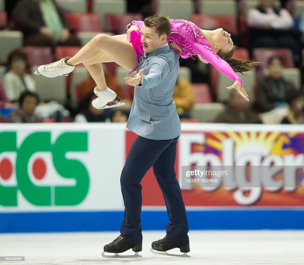 Ice dancers Julia Zlobina and Alexei Sitnikov of Azerbaijan skate their short program at Skate America 2013 in Detroit, Michigan, October 18, 2013. AFP PHOTO / Geoff Robins