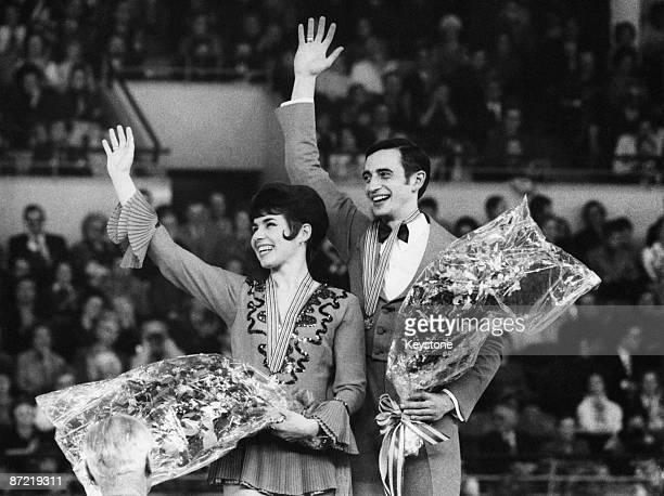Ice dancing champions Aleksandr Gorshkov and his wife Lyudmila Pakhomova of the Soviet Union on the podium at the World Figure Skating Championships...
