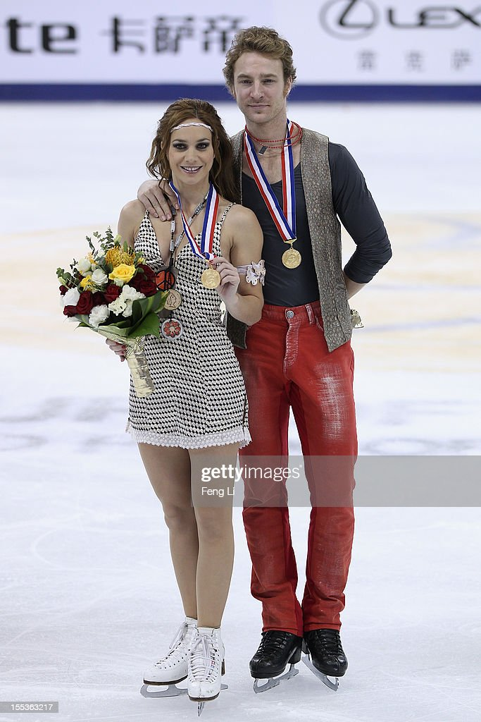 Ice dancing gold medalists Nathalie Pechalat and Fabian Bourzat of France pose for photo during the medal ceremony of Cup of China ISU Grand Prix of Figure Skating 2012 at the Oriental Sports Center on November 3, 2012 in Shanghai, China.