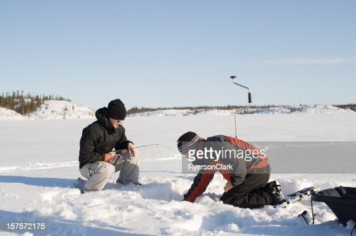 Ice fishing yellowknife stock photo getty images for Ice fishing apps