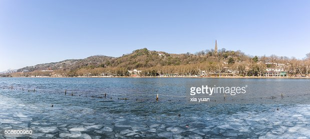 Ice floes floating on the West Lake against Baoshi Hill ,Hangzhou,Zhejiang,China : Stock Photo