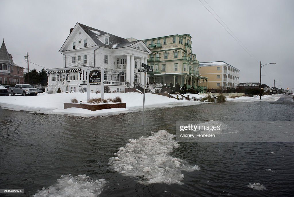 Ice forms as the winter storm mixed with high tide causes flooding on Beach Avenue on January 23 2016 in Cape May New Jersey A major snowstorm is...