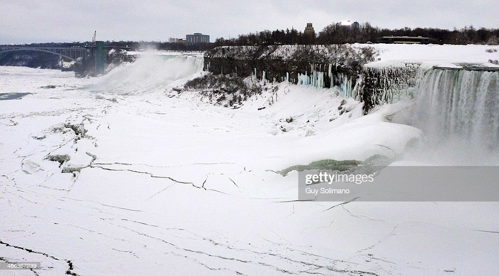 Ice forms on the Niagara River in front of the American Falls on the left and the Canadian Horseshoe Falls on the right on February 5, 2014 in Niagara Falls, Canada. An additional foot of snow blanketed Western New York overnight in the latest winter storm system that has affected areas from Kansas to Maine..