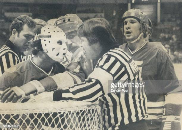 Ice Hockey Colorado Rockies Whalers Goaltender John Garrett exchanging words with judge Newell keeping them apart is whalers Gordie ***** 1st period...