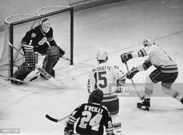 Ice Hockey Colorado Rockies Coming Up One Rockies Goal Pierce Fires on Boston's Gilles Gilbert Colorado's Randy Pierce is ready to pull the trigger...