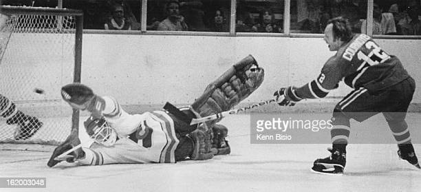 NOV 16 1977 NOV 17 1977 Ice Hockey Colorado Rockies First goal of game 1727 of 2nd period Canadiens' Yvan Cournoyer lifts a rebound of a Pete...