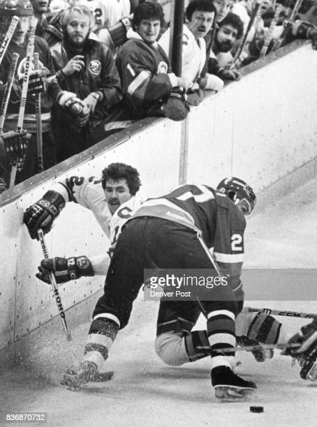 Ice Hockey Colorado Rockies Rockies' Bobby MacMillan rear ends up on ice after he was checked by Islanders' John Tonelli during early action Credit...