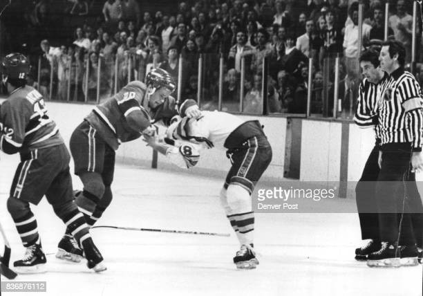 Ice Hockey Colorado Rockies Rockies' Bobby Miller tangles with Canadiens Mark Hunter while officials Bob Meyer and Ryan Bozak watch action ***** #18...