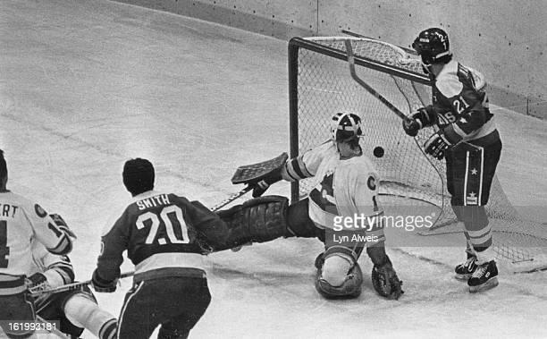 JAN 12 1981 JAN 13 1981 Ice Hockey Colorado Rockies Rockies vs Capitals 2nd goal by Capitals 1st period R#14 Rene Robert C Rick Smith R Hardy Astrom...
