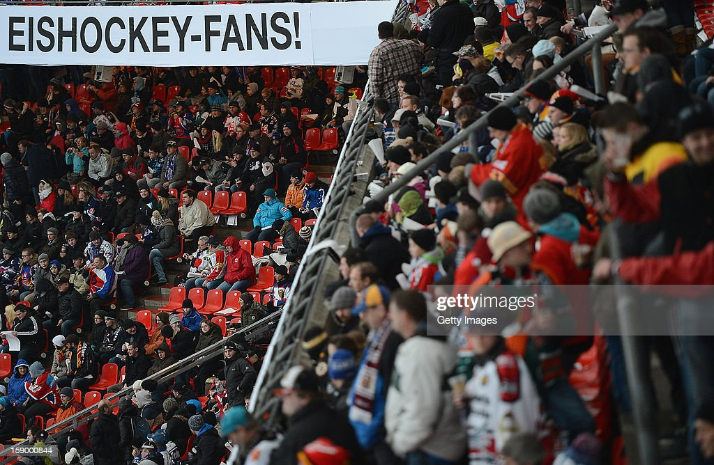 Ice hockey fans sitting and staying on the stands during the DEL Winter Game 2013 at Stadion Nuernberg on January 5, 2013 in Nuremberg, Germany.