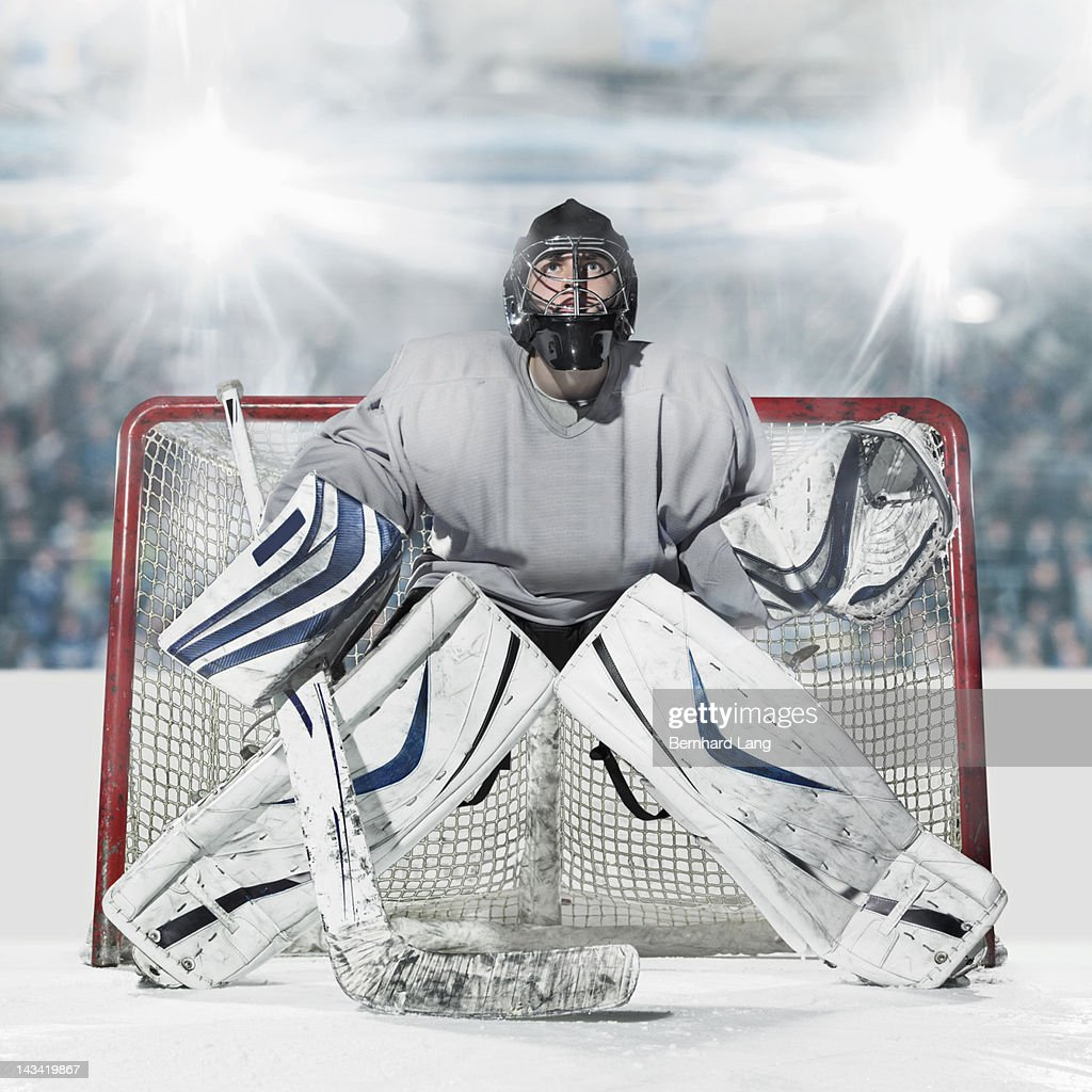 Ice hockey goal keeper in front of goal