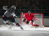 Ice hockey goalkeeper blocking a shot