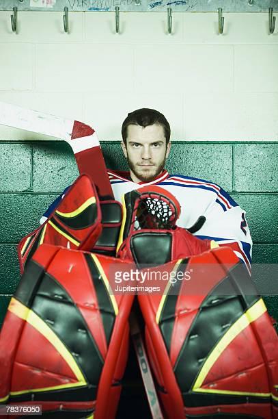 Ice hockey goaltender sitting on bench