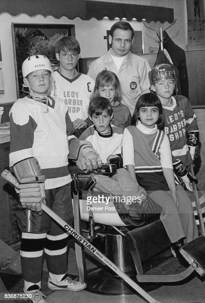 Ice Hockey Leo Bayer Poses With his Hockey Family in his Barber Shop Standing from left are Kerry Doug Brenda Leo and Jeff seated in the barber chair...