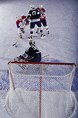 Ice Hockey player attacking goal, elevated view