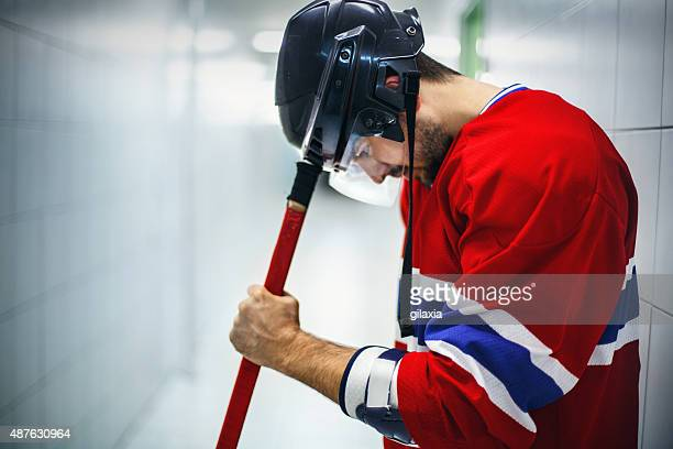 Ice hockey player focusing before the game.