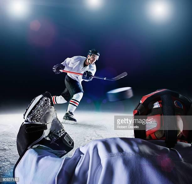 Ice Hockey Player shooting goal