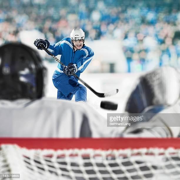 Ice hockey player shooting on goal